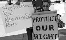 Carlos Parkins and Annie Mora stand up for housing rights at rally in Oakland. Photo: CJJC archives